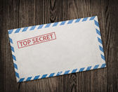 Old top secret envelope on table. — Stock Photo