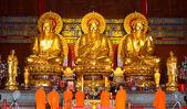 Monk and golden buddha — Stock Photo