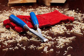 Chisels, red gloves and wood shavings — Stock Photo
