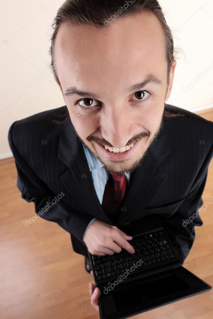 Young successful business man working at office — Stock Photo #4190573
