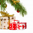 Boxes with gifts under a christmas fur-tree — Stockfoto