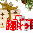 Boxes with gifts under a christmas fur-tree — Stock Photo #4203133