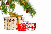 Boxes with gifts under a christmas fur-tree — Stock Photo