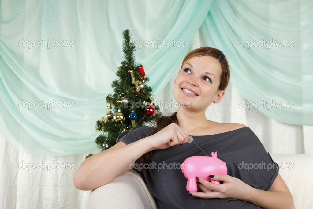 The young beautiful woman decorate a christmas fur-tree  — Stock Photo #4403967