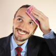 The businessman wipes a forehead by kerchief — Stock Photo