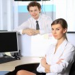 Stock Photo: Business womand her colleague working at office