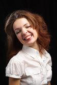 Girl show tongue isolated black background — Stock Photo