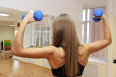 Sport girl with strong back — Stock Photo