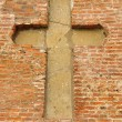 Stock Photo: Cross in masonry