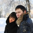 Young couple on a walk in the park in winter - Stock Photo