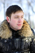 The young man, brooding eyes, a walk in the Winter Park — Stock Photo