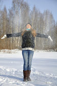 Young girl playing with snow in the park — Stock Photo