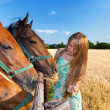 Royalty-Free Stock Photo: Horse and blond girl in paddock on summers