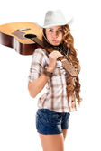 Sesy cowgirl in cowboy hat with acoustic guitar — Stock Photo