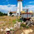 Lighthouse on mediterranean coastline — Stock Photo