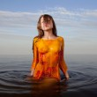 Girl posing in the Water at sunset — Stock Photo