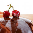 Cherry and chocolate on breast — Stock Photo