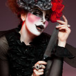 Woman mime with knife - Foto Stock