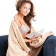 Young woman sitting on chair covered with blanket — Stock Photo #5338149