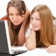 Two young happy student girl work on laptop — Stock Photo #5355313