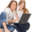 Two young happy student girl work on laptop — Stock Photo #5355392