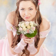 Beautiful woman dressed as a bride - Stock Photo