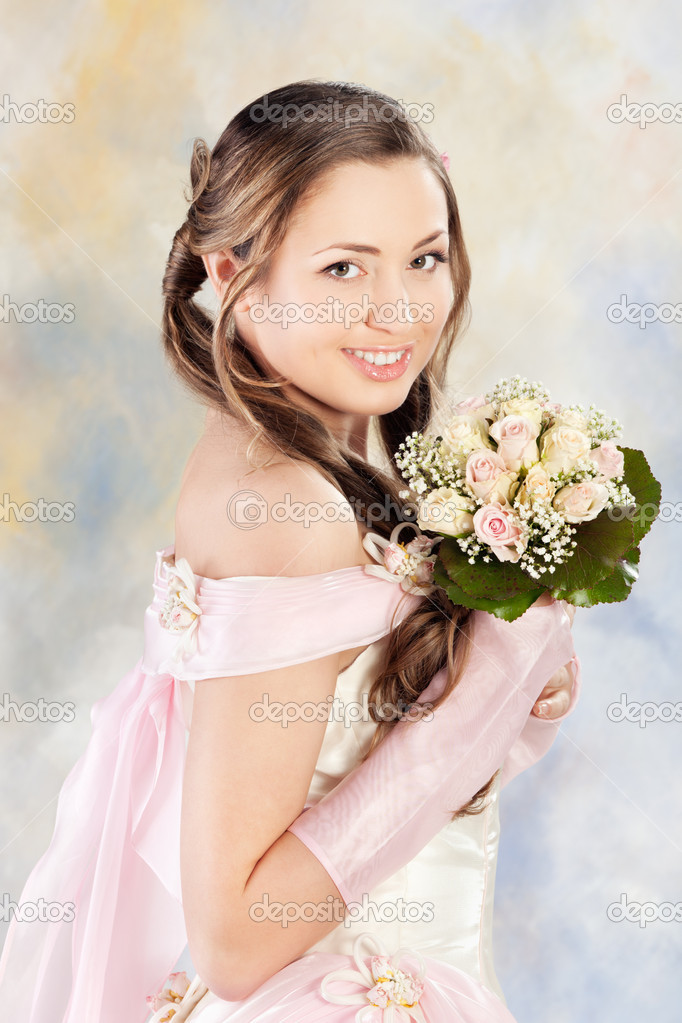 Beautiful woman dressed as a bride over colored background.  Stock Photo #5362680