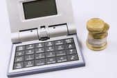 Calculator and Coins — Stock Photo