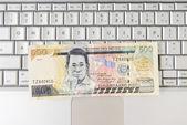 Money on Computer Keyboard — Stock Photo