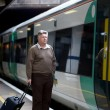 Mature man on railway station — Foto Stock