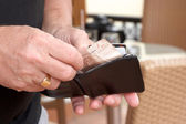 Man taking money out of wallet — Stock Photo