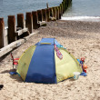 Beach tent at water edge — Stock Photo