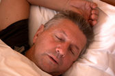 Mature man sleeping — Stock Photo