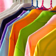 Stock Photo: Colorful t-shirt on hangers