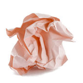 Ball of crumpled pink paper — Stock Photo