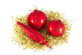Red Christmas ornaments on gold. — Stock Photo
