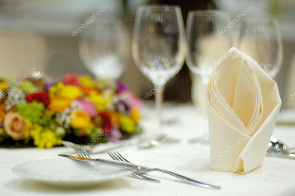 Dining table with flower decoration — Stock Photo #4014420