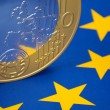 Euro coin on a european flag — Stock Photo #4024229