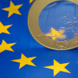 Euro coin on a european flag — ストック写真