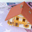 House model on euro banknote — Stock Photo