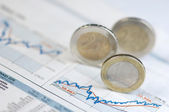 Euro coins on a share chart — Stock Photo