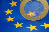 Euro coin on a european flag — Stock Photo