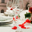 Covered banquet with red roses decoration — Stock Photo #4032865