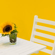 Stock Photo: Sunflower on a white table