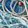 Stock Photo: Disordered blue fishing nets