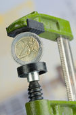 Eurocoin in a clamp — Stock Photo
