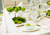 Table decoration with lime — Stock Photo