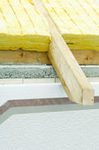 Thermal insulation of a house roof and plastered facade — Stock Photo