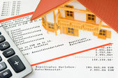 Model house on a bank account — Stock Photo