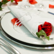 Covered banquet with red roses decoration — Stock Photo #4040298